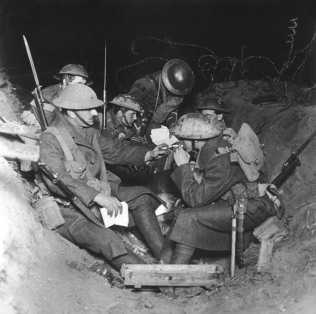 British troops resting and lighting a cigarette at Beaumont Hamel, Somme, on the Western Front in France during World War I in 1917 Date: 1917