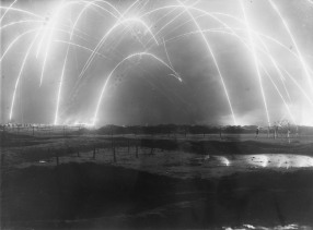 Flares in the night sky over a battlefield during the First World War. Date: 1914-1918