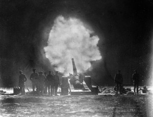 A naval gun firing over Vimy Ridge behind Canadian lines at night on the Western Front in northern France during the First World War. Date: May 1917