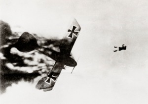 German pilot jumping from his burning Albatross aeroplane after it was shot down over enemy lines during World War One. Photograph from a series on aerial combat, the majority of the photographs were taken by a British pilot. The pilot recounted the fight that led to this picture: 'A Hun went down under control and Jock (fellow pilot) nosed after it to get it. Then saw it on fire and followed it down, watching pilot struggle to bring it all the way down. Heat must have been terrific. Noticed pilot trying to jump out...Camera caught him just as he left the burning plane.'